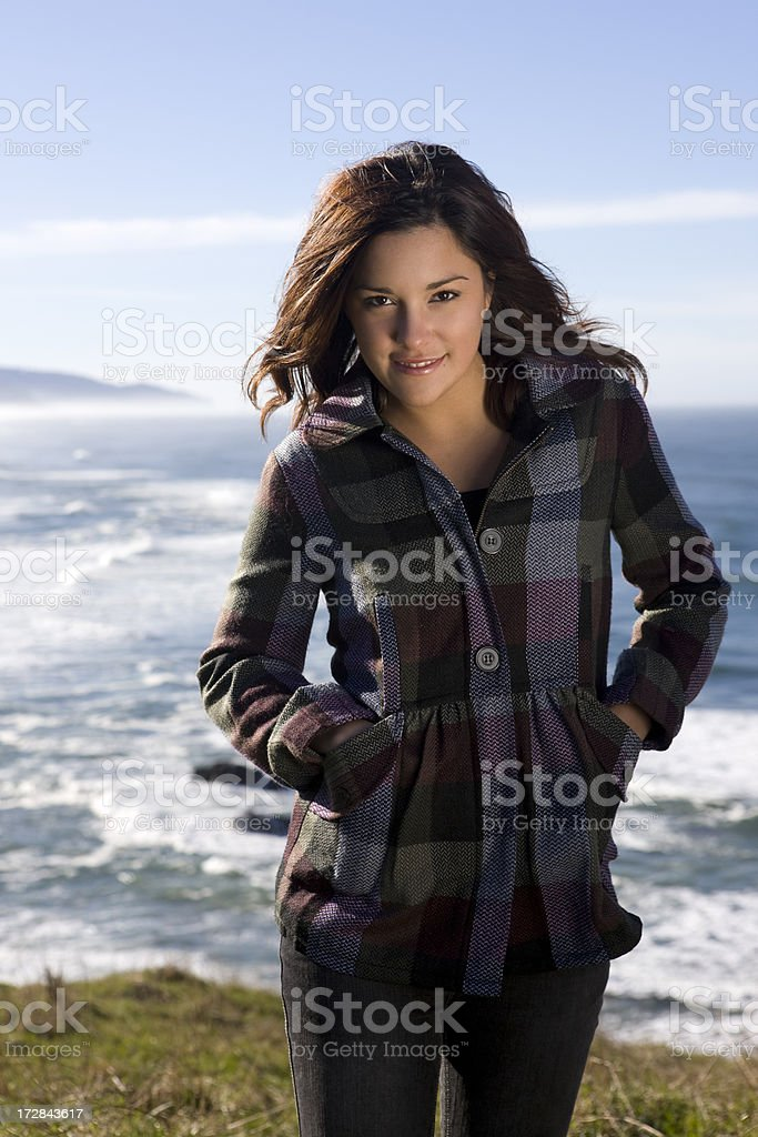 Beautiful Latina Young Woman Portrait on Coastal Cliff, Ocean Background royalty-free stock photo
