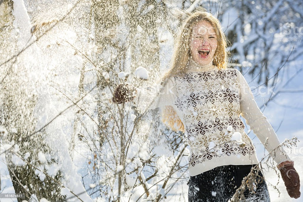 Beautiful laughing girl in snow royalty-free stock photo