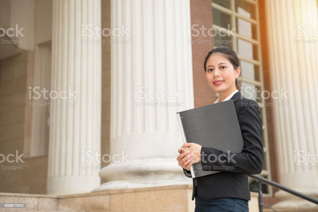 beautiful legal adviser manager standing in court stock photo