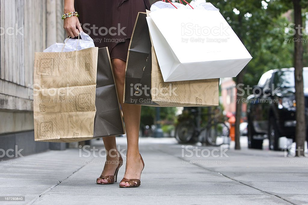 Beautiful Legs of Woman on Sidewalk with Shopping Bags, Copyspace royalty-free stock photo