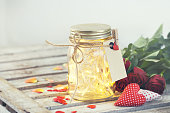 Beautiful lights, garland in a jar with hearts, love concept