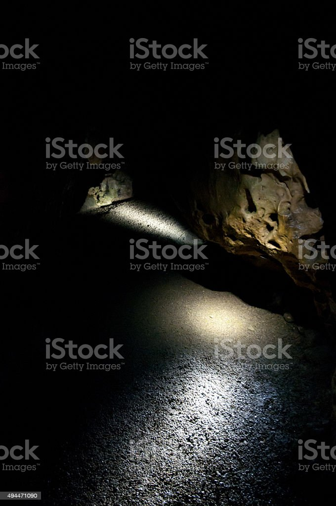 beautiful lights in black cavern stock photo