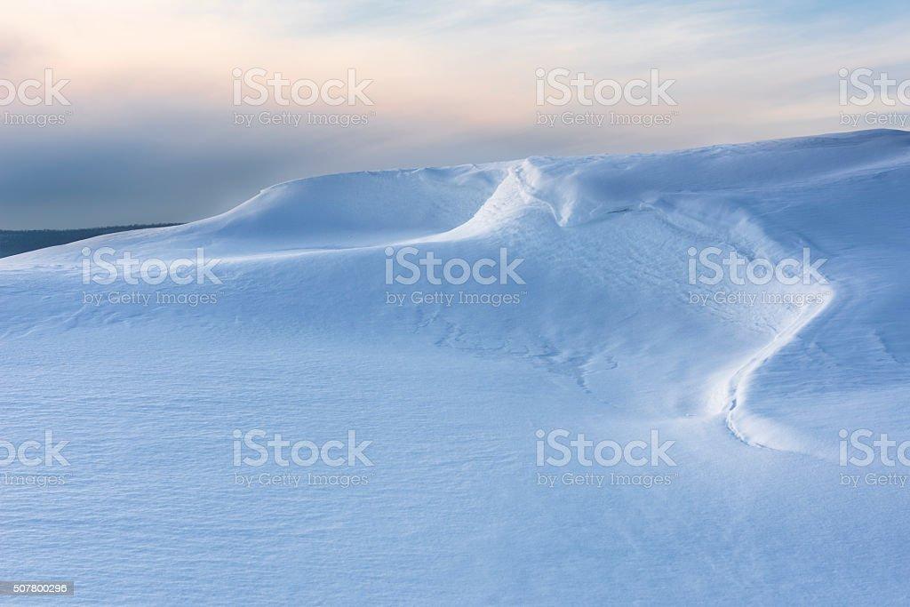 Beautiful Lines of Snowdrift in Evening Light stock photo