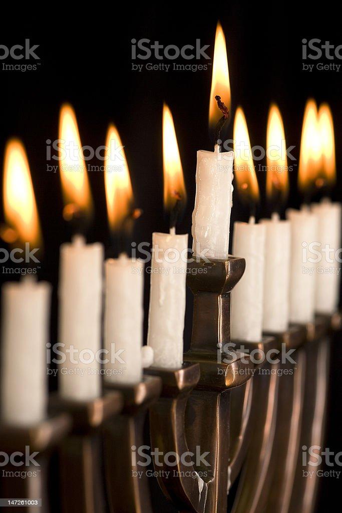 Beautiful lit hanukkah menorah on black. royalty-free stock photo