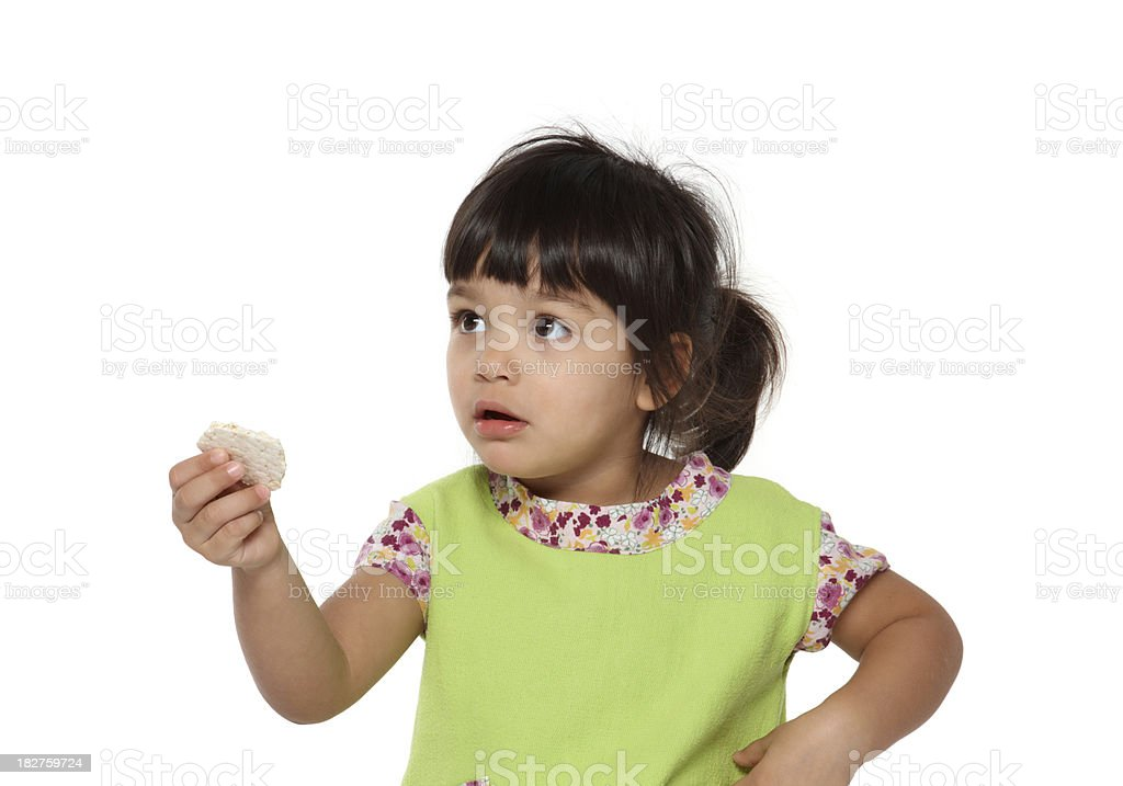 beautiful little baby girl offering a cookie stock photo