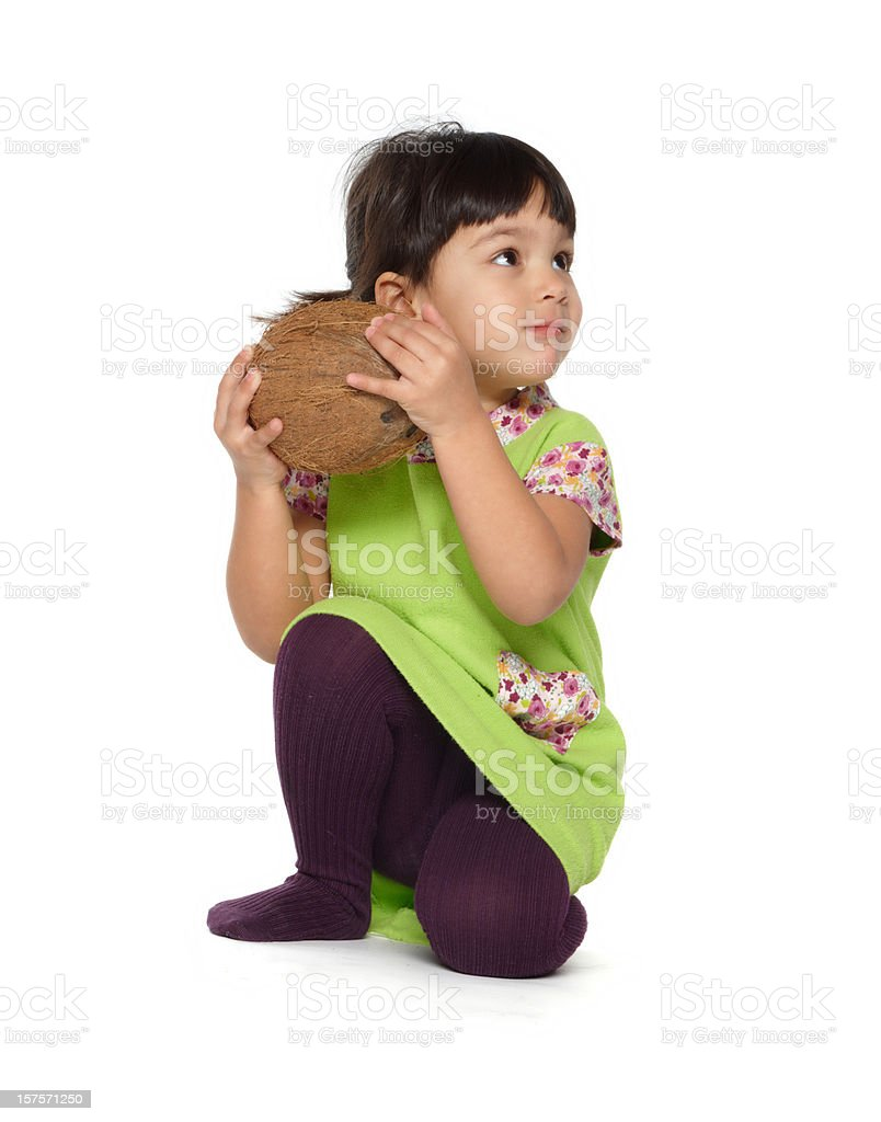beautiful little baby girl with a coconut stock photo