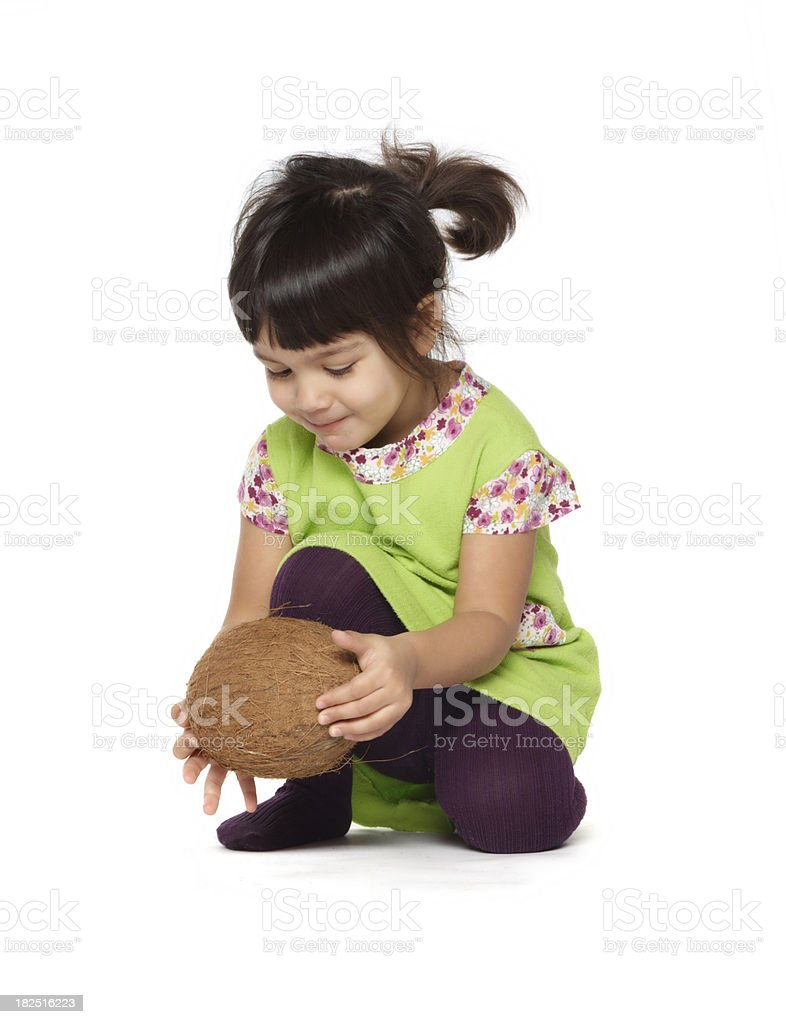 beautiful little baby girl with a coconut royalty-free stock photo