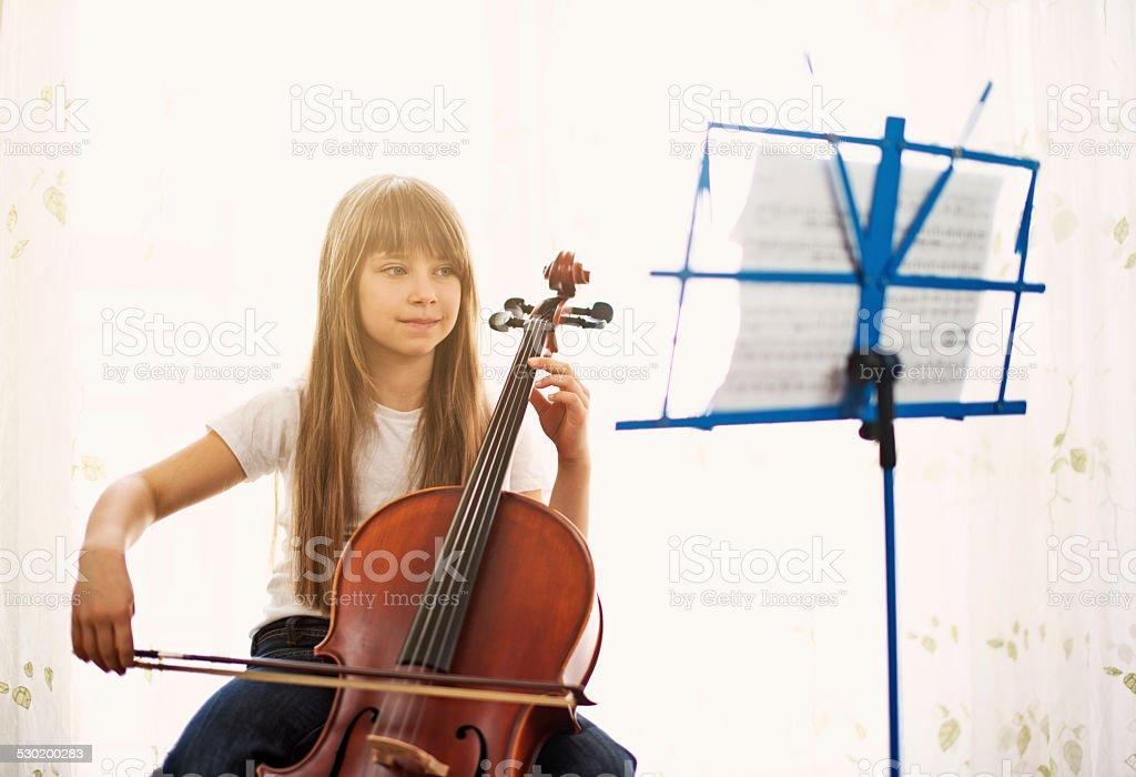 Beautiful little cellist stock photo