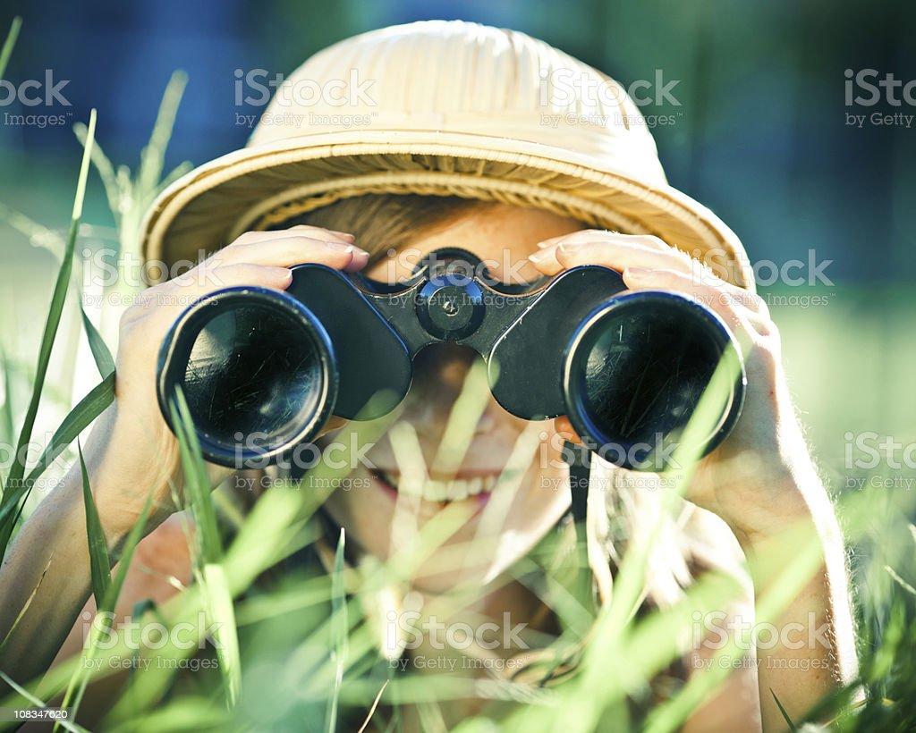 beautiful little explorer girl with binoculars at park royalty-free stock photo