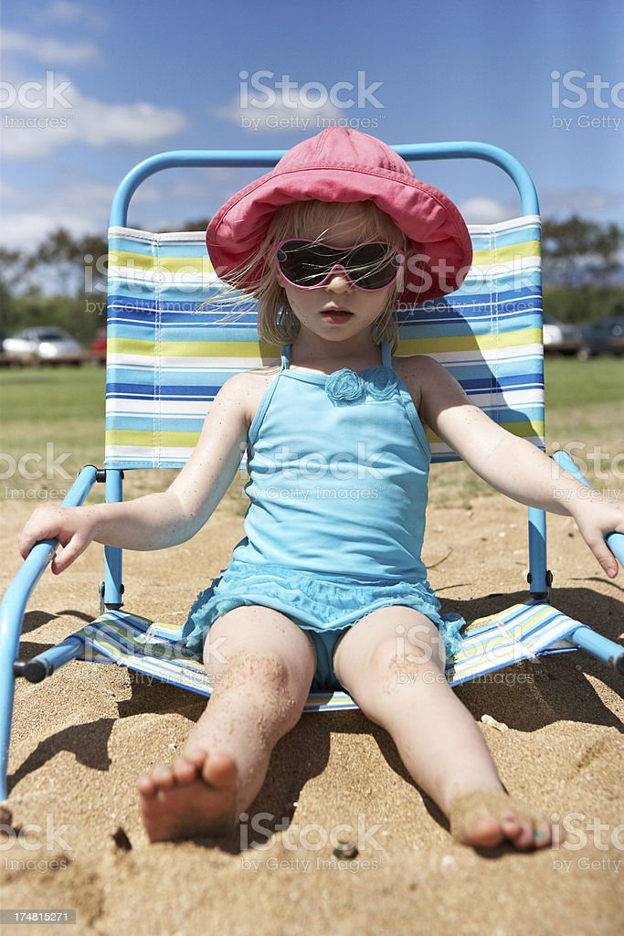 Beautiful little girl at the beach wearing sunglasses royalty-free stock photo
