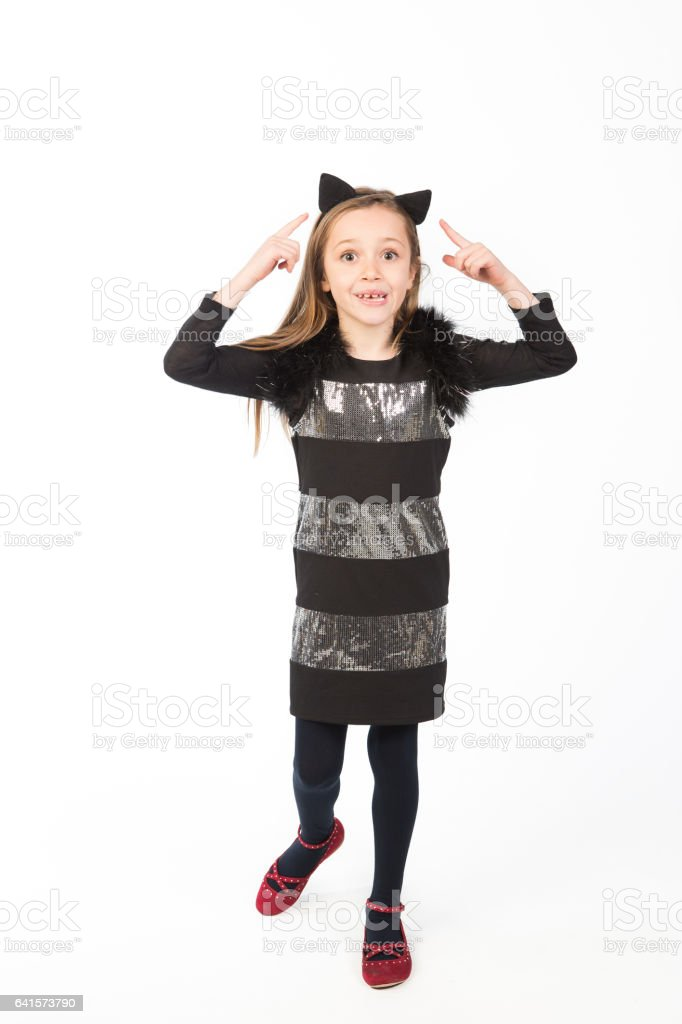 Beautiful little girl dressed as a cat stock photo