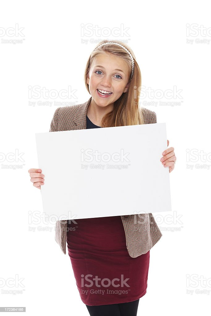 Beautiful little girl holding a blank signboard smiling against royalty-free stock photo