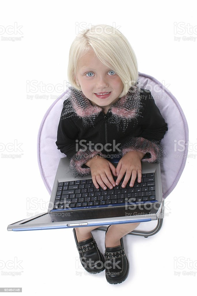 Beautiful Little Girl In Chair With Laptop Computer royalty-free stock photo