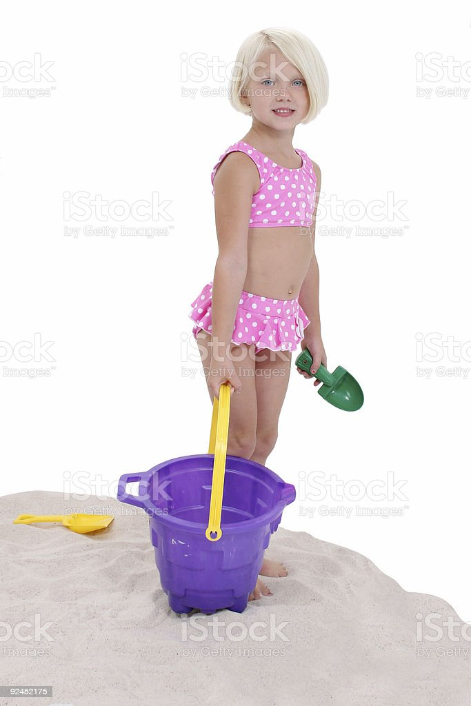 Beautiful Little Girl In Pink Swim Suit With Beach Toys royalty-free stock photo