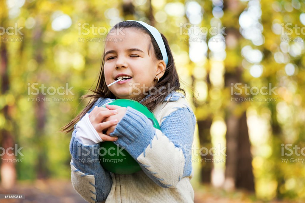 Beautiful little girl in the park stock photo