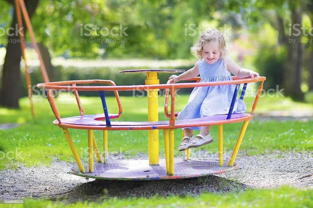 Beautiful little girl on a playground stock photo
