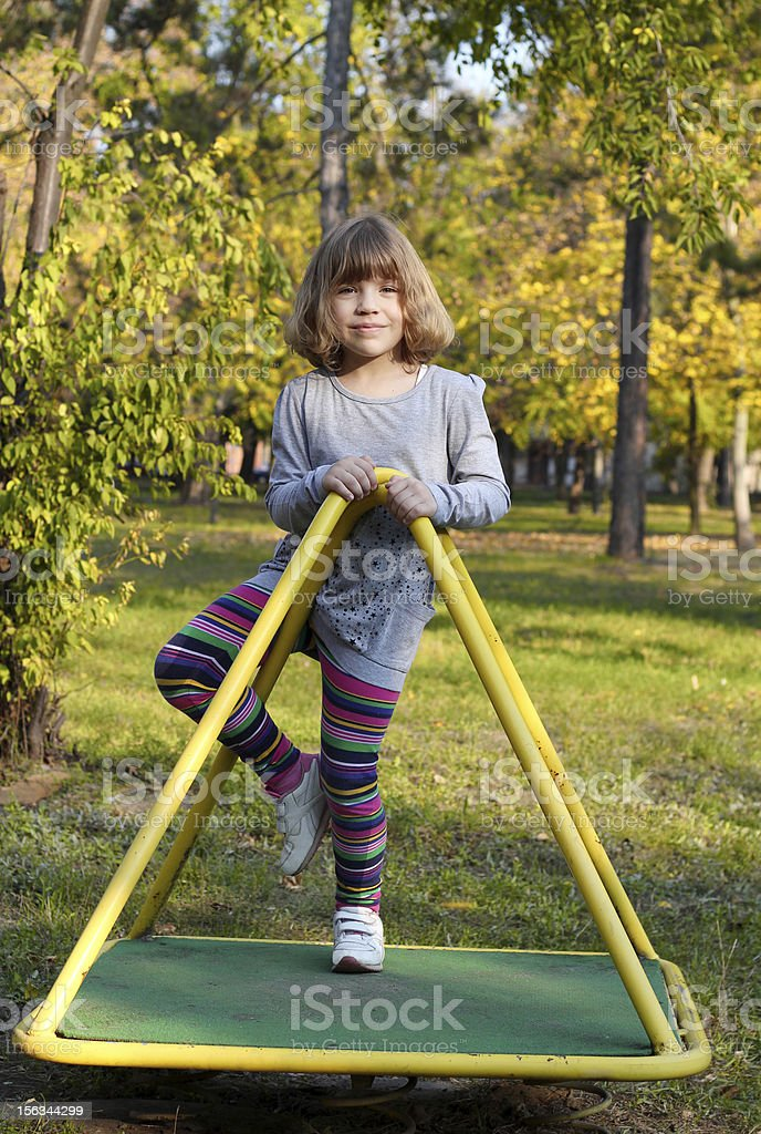 beautiful little girl on playground royalty-free stock photo