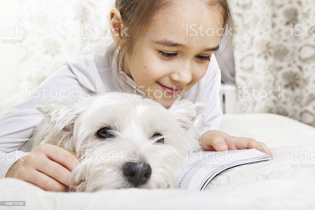 Beautiful little girl reading royalty-free stock photo