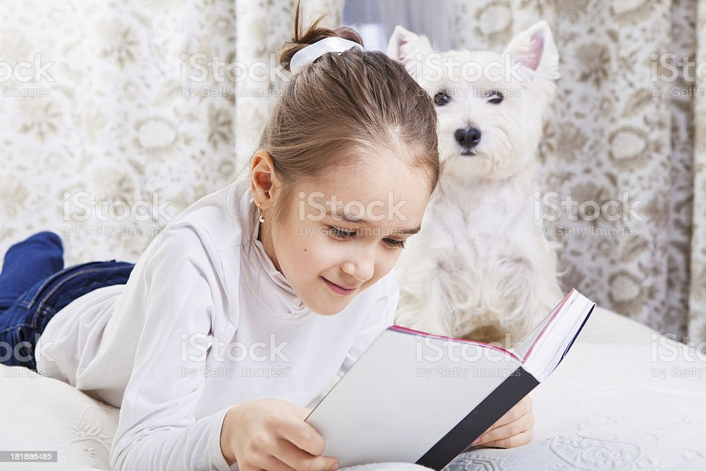 Beautiful little girl reading royalty-free stock photo