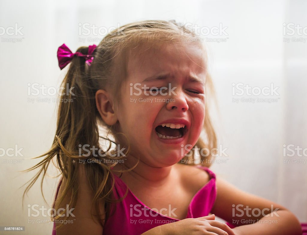 beautiful little girl, showing emotions, crying, offended Princess stock photo