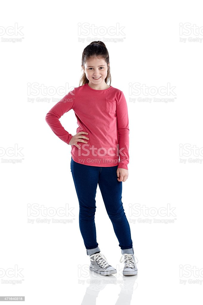 Beautiful little girl standing on white stock photo