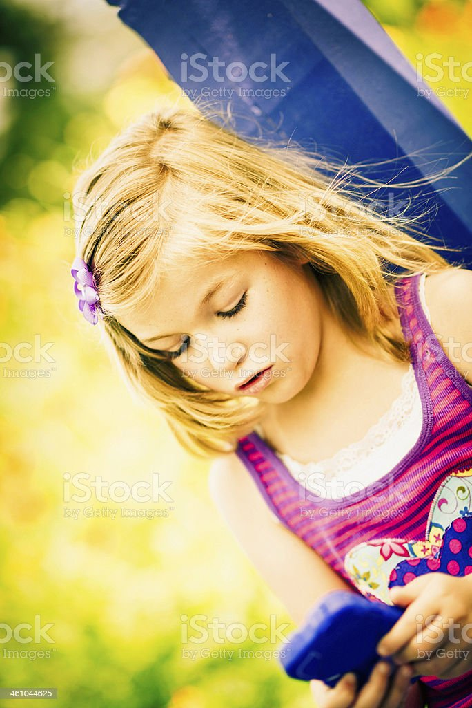 Beautiful Little Girl Texting on Cell Phone royalty-free stock photo