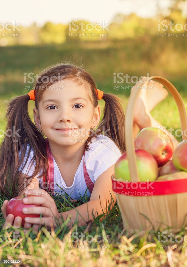 Beautiful Little Girl With Apples stock photo