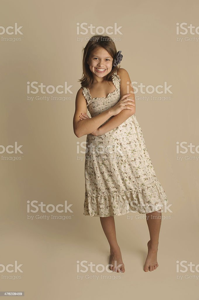 Beautiful Little Girl With Arms Crossed Wearing Flower in Hair royalty-free stock photo