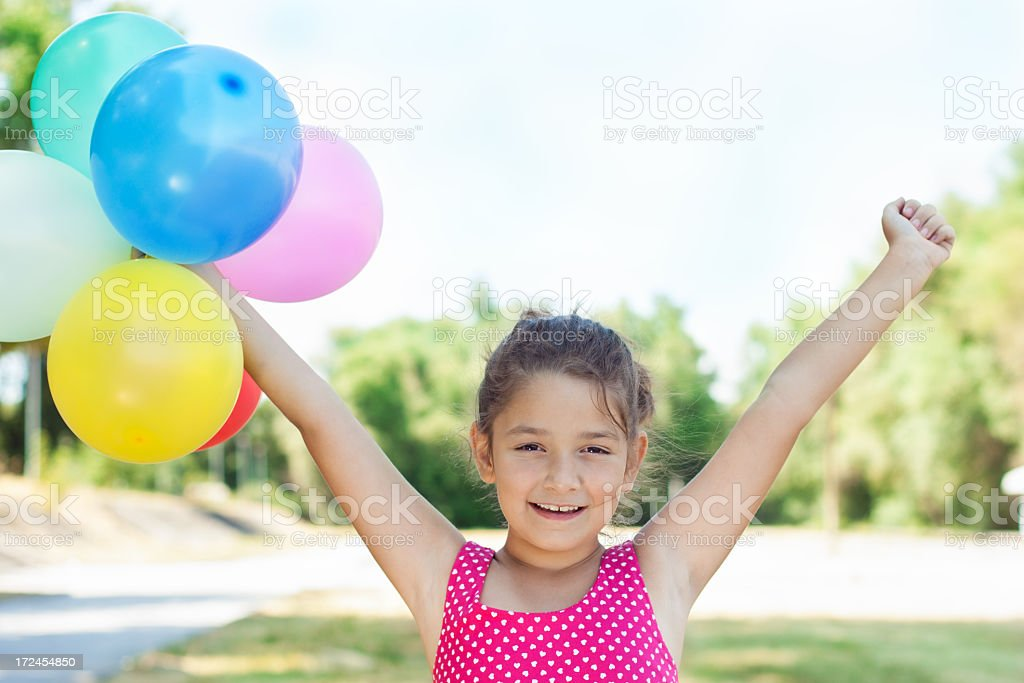 Beautiful little girl with balloons royalty-free stock photo
