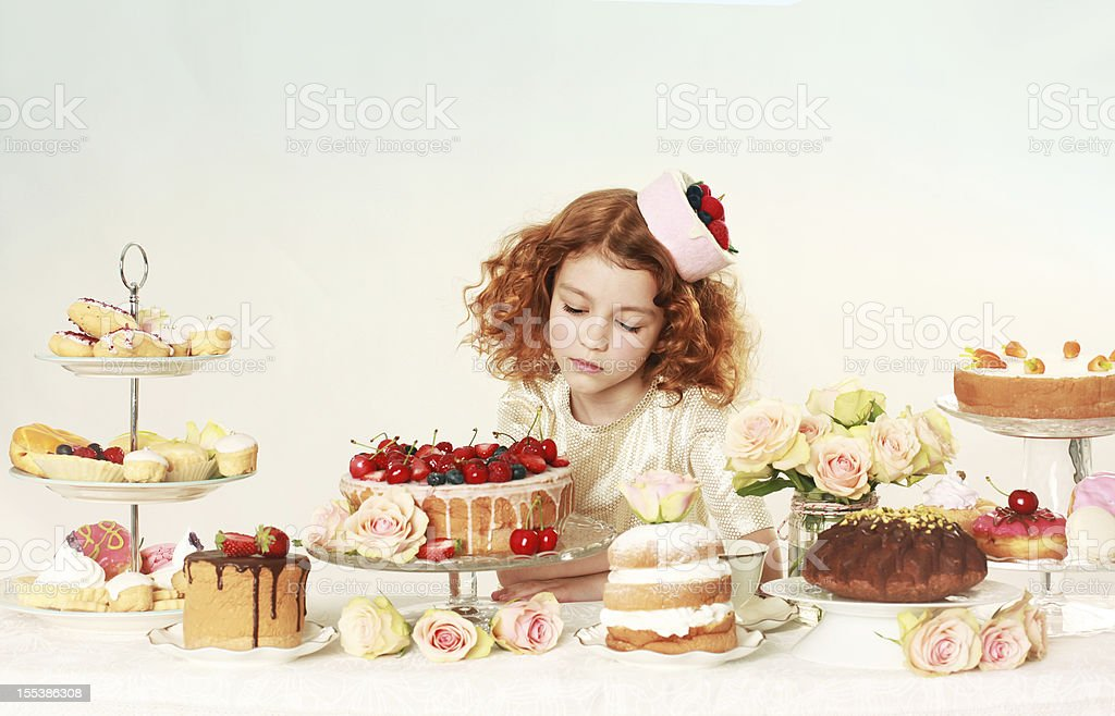 Beautiful little girl with cakes stock photo