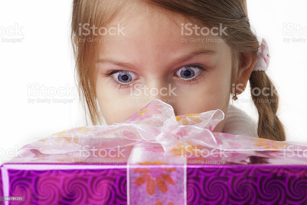 beautiful little girl with gift box surprised stock photo
