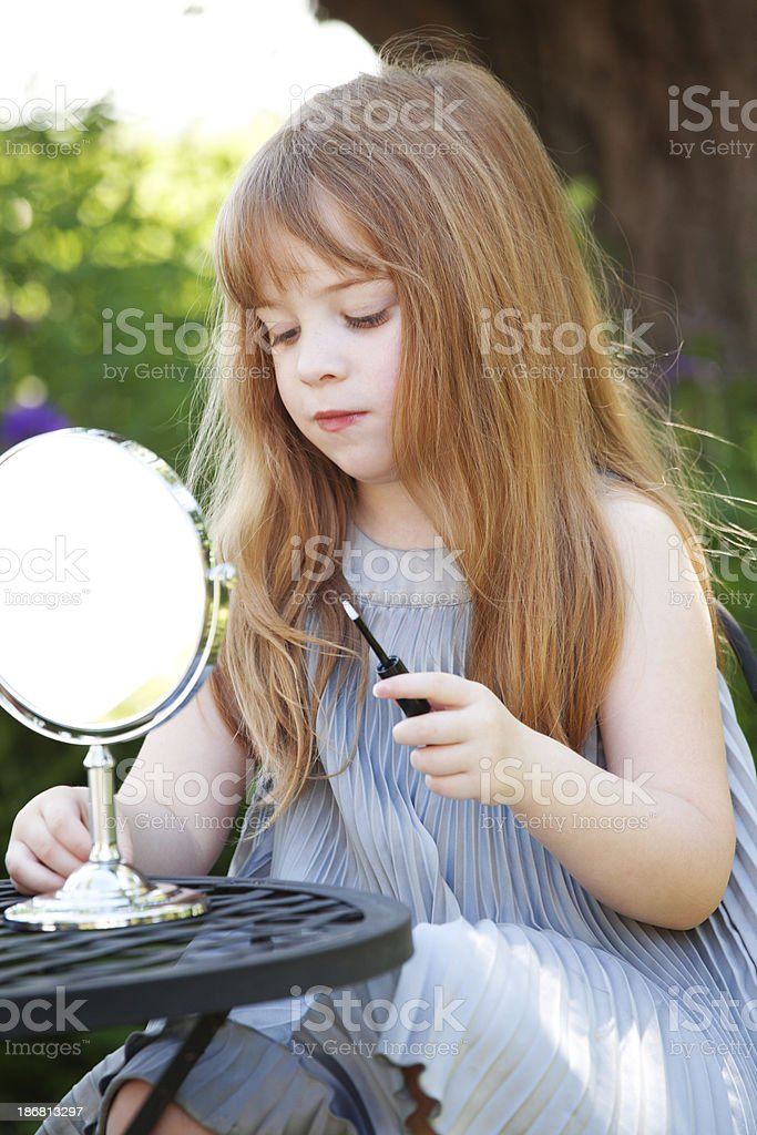 Beautiful Little Girl with Lipstick and Mirror royalty-free stock photo