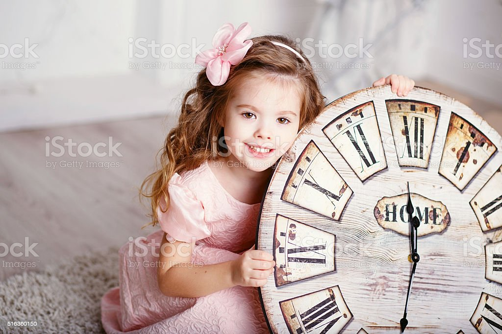 Beautiful little girl with long curly hair stock photo