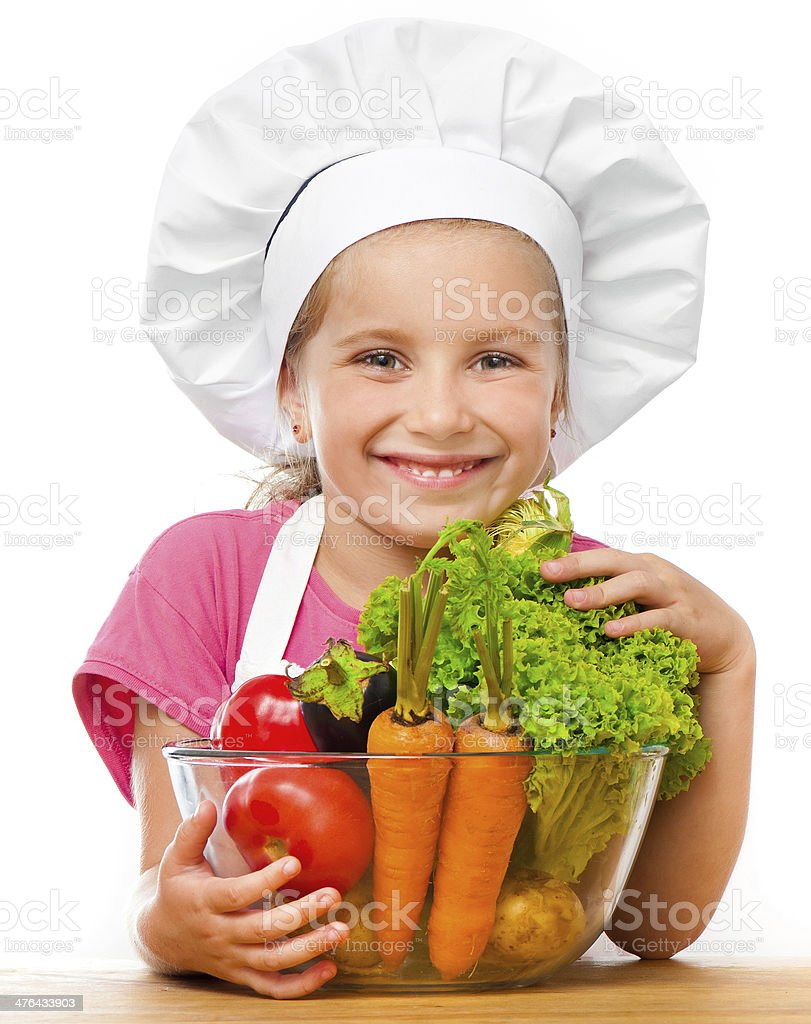beautiful little girl with vegetables royalty-free stock photo