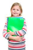 Beautiful little schoolgirl isolated on white background