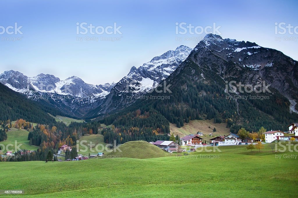 Beautiful little village between snow covered mountains stock photo