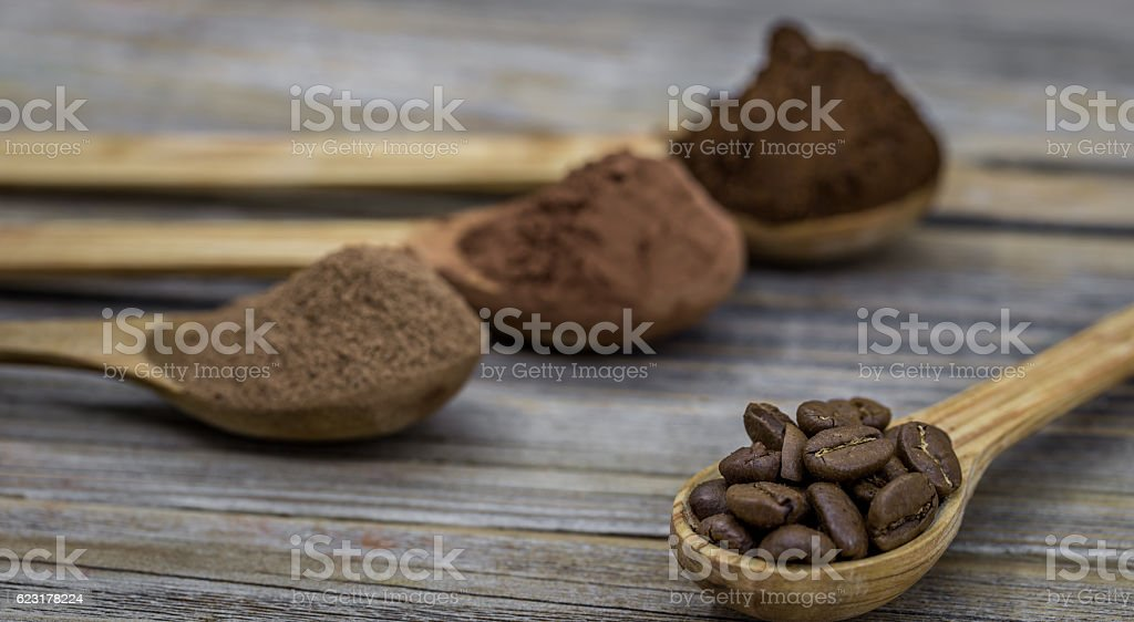 beautiful little wooden spoon with coffee on  background stock photo