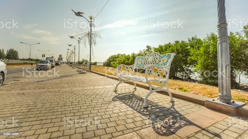 Beautiful lone bench on the path stock photo