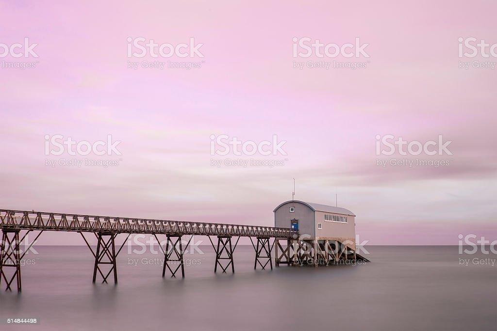 Beautiful long exposure landscape image of jetty at sea stock photo