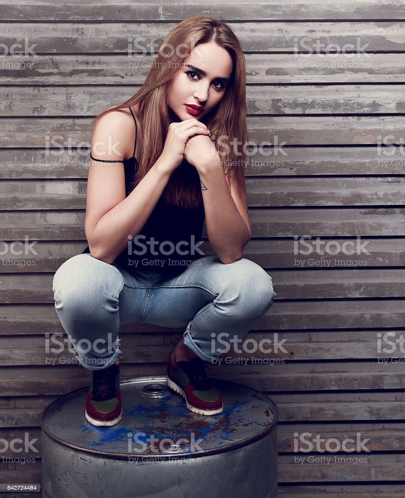 Beautiful long hair woman thinking with hands under face sitting stock photo