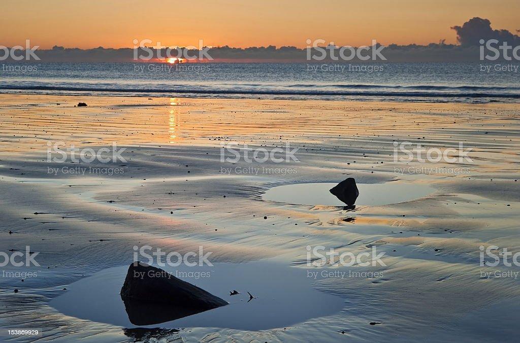 Beautiful low tide beach vibrant sunrise royalty-free stock photo