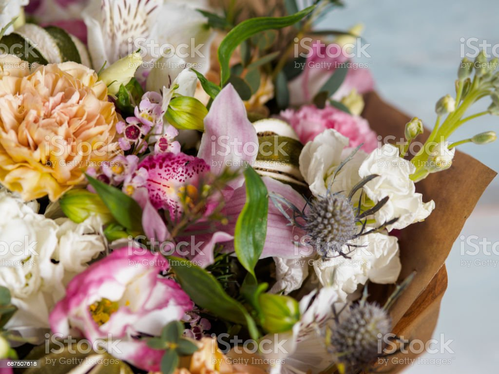 beautiful lush bouquet with different spring flowers, turquoise background, view from the top stock photo