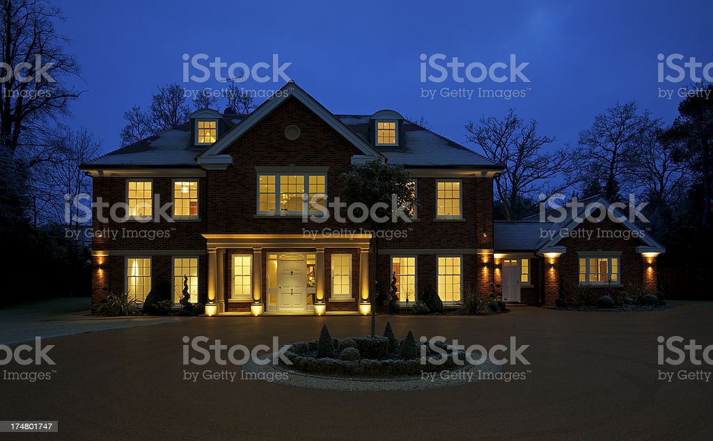 beautiful luxury home at dusk stock photo