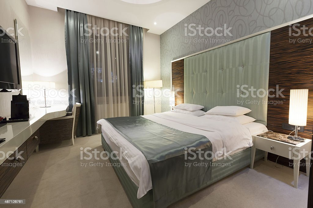 Beautiful luxury hotel double bed room stock photo