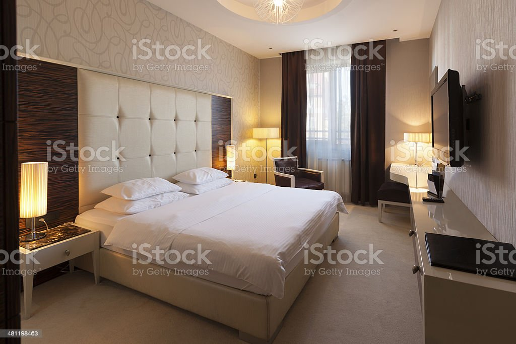 Beautiful luxury hotel room with double bed royalty-free stock photo