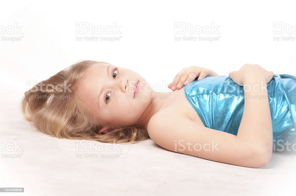 Beautiful lying young girl with long blond hair stock photo