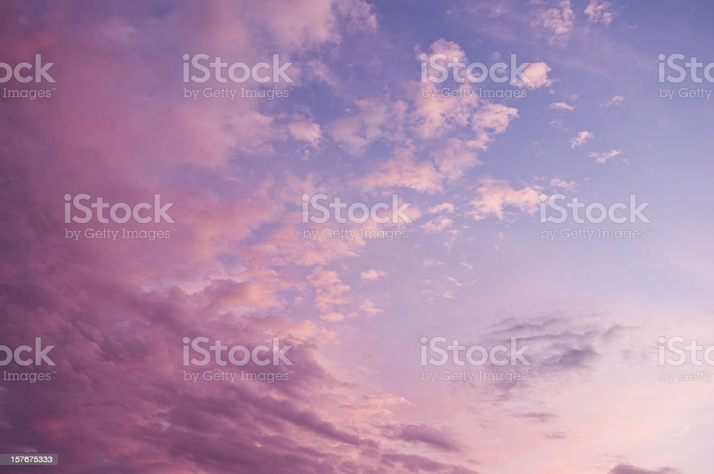 Beautiful magenta-blue sunset sky with clouds. stock photo