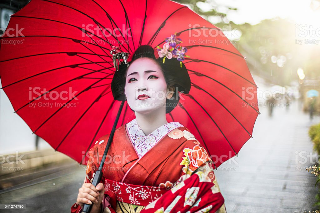 Beautiful Maiko in the streets of Kyoto stock photo