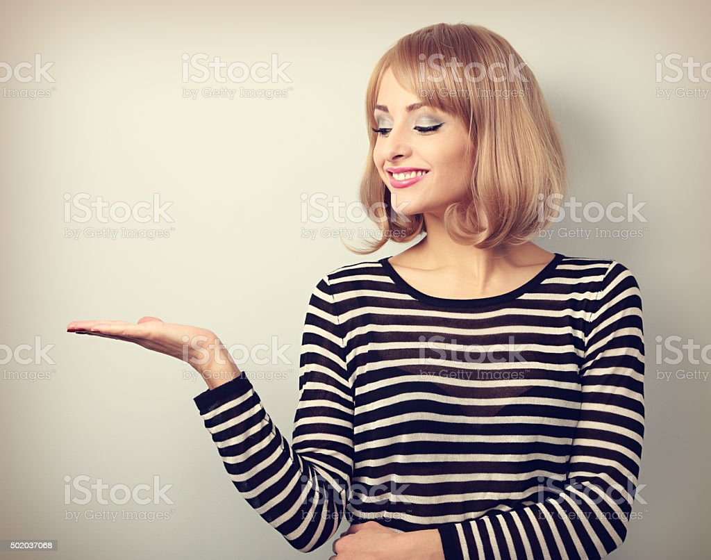 Beautiful makeup blond woman holding and looking on something stock photo