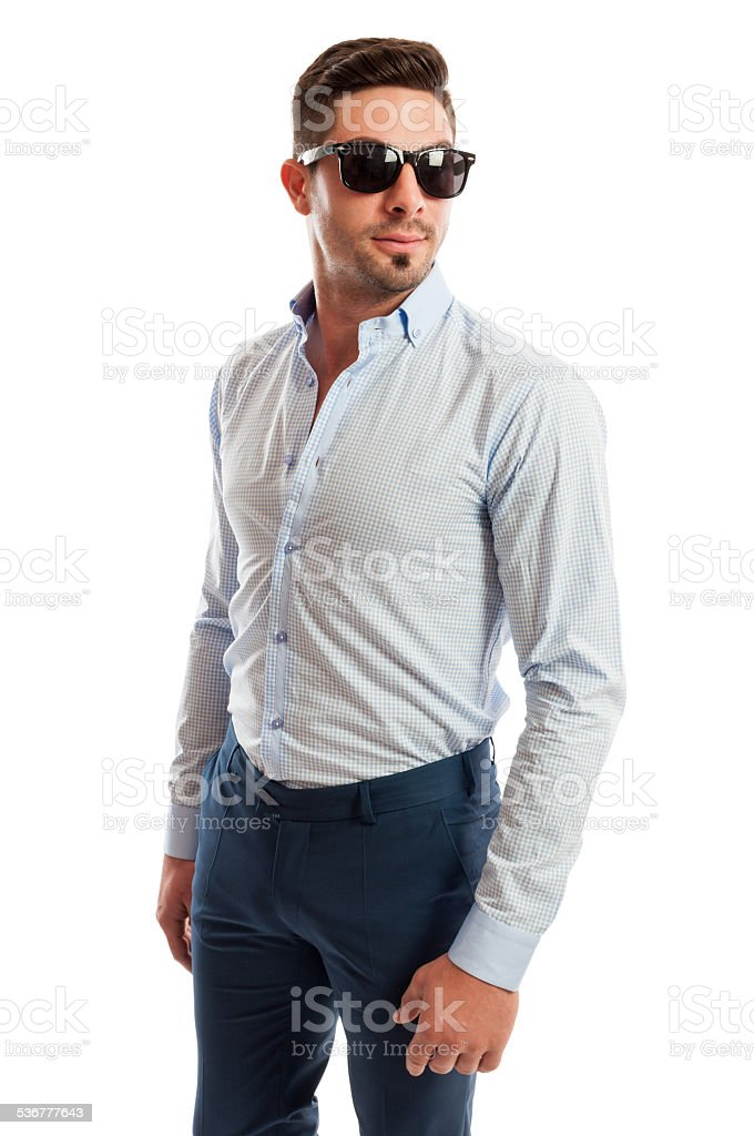 Beautiful male model wearing open shirt and tight pants stock photo